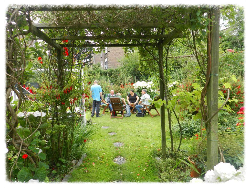 group of people relaxing in garden